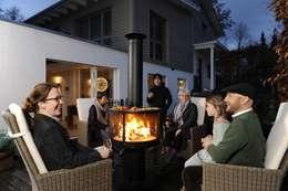 Outdoor-Feuerstelle Rüegg SURPRISE: klassischer Balkon, Veranda & Terrasse von Rüegg Cheminée Schweiz AG