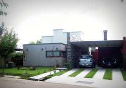 Fachada principal: Casas de estilo moderno por VYC Arquitectura