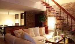 Salas / recibidores de estilo  por Estudio de Arquitectura 2E+1L