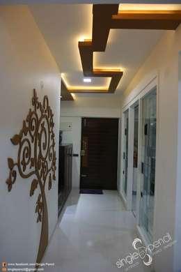 kishore:  Corridor & hallway by single pencil architects & interior designers