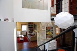 Couloir et hall d'entrée de style  par MAGA - Diseño de Interiores