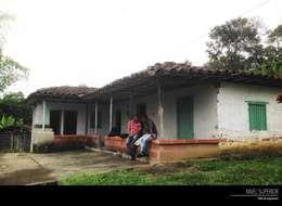 Casas de estilo rural por NIVEL SUPERIOR taller de arquitectura