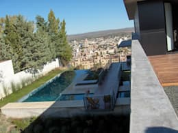 Casa en Barrio Gamma: Casas de estilo moderno por aercole