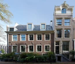 Herengracht + Bergstraat: klasieke Huizen door Architectenbureau Vroom