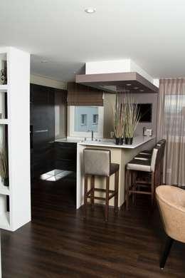 Création d'un appartement en copropriété: Cuisine de style de style Moderne par CSInterieur