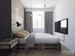 Dormitorios de estilo industrial por PASS architekci