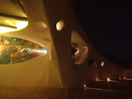 Arched openings at night: mediterranean Garden by The White Room