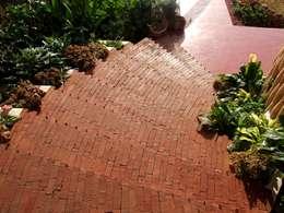 Close up of Brick steps: mediterranean Garden by The White Room