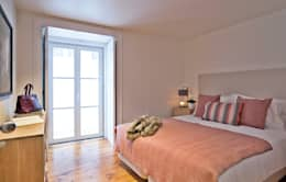 Dormitorios de estilo  por Pureza Magalhães, Arquitectura e Design de Interiores