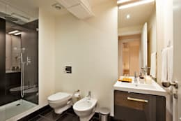 Baños de estilo industrial por Pureza Magalhães, Arquitectura e Design de Interiores