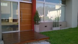 Casas de estilo moderno por Arq Andrea Mei   - C O M E I -
