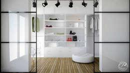 Vestidores y closets de estilo moderno por Progetti Architektura