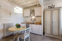 rustic Kitchen by STUDIO ARCHIFIRENZE