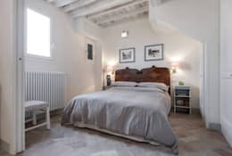 Habitaciones de estilo rústico por STUDIO ARCHIFIRENZE