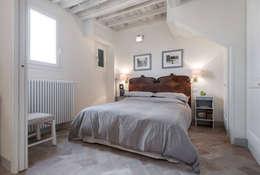 rustic Bedroom by STUDIO ARCHIFIRENZE