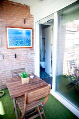 Terraza de la vivienda: Terrazas de estilo  de Arquigestiona Reformas S.L.