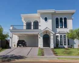 Casas de estilo ecléctico por Marcelo Lopes Arquitetura