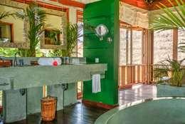 Baños de estilo asiático por Buseck Architekten