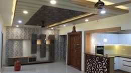 Mr. and Mrs. Raghu House at Shoba Forest view : modern Living room by Blue Interiors