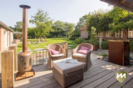 Landelijke achtertuin met stoer paviljoen: landelijke Tuin door Van Mierlo Tuinen | Exclusieve Tuinontwerpen