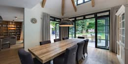 country Dining room by DENOLDERVLEUGELS Architects & Associates