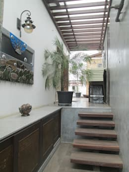 Third  floor terrace - after:   by Uncut Design Lab