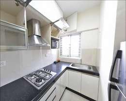 kitchen : minimalistic Kitchen by Uncut Design Lab