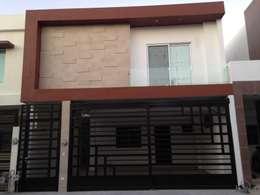 FACHADA:  de estilo  por OR Arquitectura y Construcción