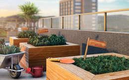 Jardines de estilo moderno por Tato Bittencourt Arquitetos Associados