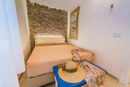 7 trucchi per arredare una stanza piccola e stretta