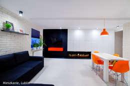 Salas / recibidores de estilo minimalista por Auraprojekt