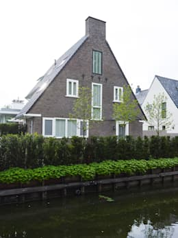 Monument aan de waterkant - vergunningsvrije uitbreiding: moderne Huizen door ENZO architectuur & interieur