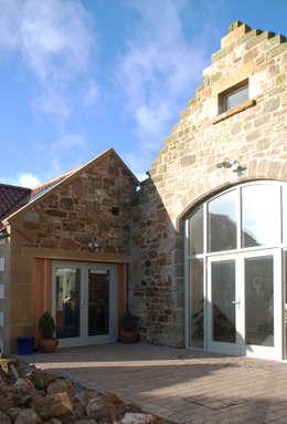 Casas de estilo rústico por Aitken Turnbull Architects