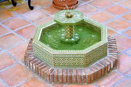 Jardines de estilo mediterraneo por Decoración Andalusí