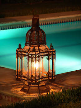 Jardín de estilo  por Decoración Andalusí Iluminación