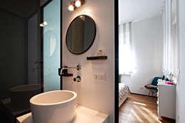 industrial Bathroom by Anomia Studio