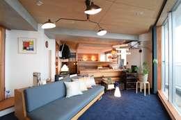 間仕切の少ない広がる空間: 合同会社negla設計室が手掛けたです。