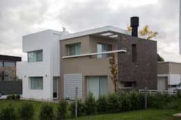 Casa DDC: Casas de estilo moderno por Zaccanti & Monti arquitectos