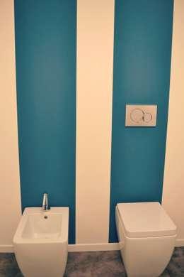 Baños de estilo industrial por Comelet s.r.l.