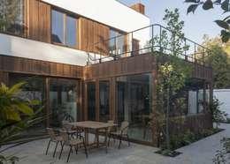 vivienda + taller : Casas de estilo moderno por PARQ Arquitectura