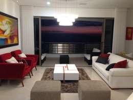 Livings de estilo moderno por John Robles Arquitectos