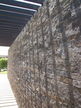 Casa Caracoli: Paredes de estilo  por David Macias Arquitectura & Urbanismo