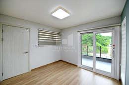 코원하우스: modern tarz Yatak Odası