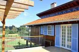 Residência G.S: Terraços  por Zani.arquitetura