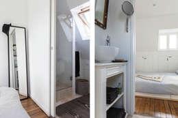 Transformation de chambres de bonne à Paris 11ème: Salle de bains de style  par GALI Sulukjian Architecte