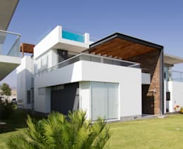 CASA DE PLAYA BARRÓN: Casas de estilo minimalista por ARKILINEA
