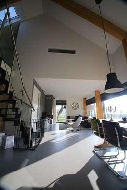 modern Living room by STUDIO = architectuur
