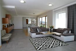 Salas de estar modernas por in2home