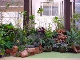 Jardines de estilo moderno por (有)ハートランド
