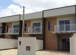 Casas de estilo moderno por mga.arq